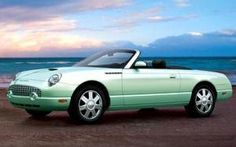 Convertible Ford Thunderbird in retro green. Ford stopped making them in 2005. Only 2 seats, completely impractical, retro cute as a button for the top down & ocean road! My husband pointed out that a convertible will make his hair messy. I suggested that he loosen up & consider the possibility that it may make him grateful (wind & all) that he STILL has hair.