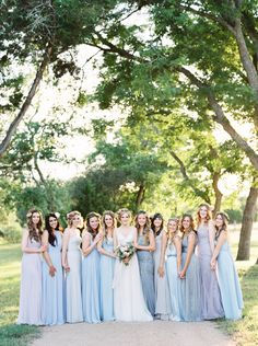 5 Style Lessons For Mismatched Bridesmaid Dresses - Shades of blue flatter just about everyone. from InStyle.com