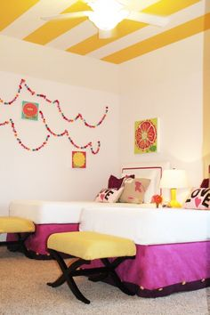LOVE the pom garland and the surprise yellow stripes on the ceiling