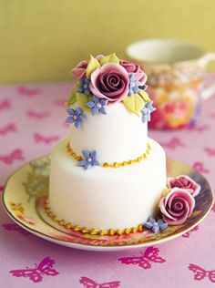 This is such a pretty mini cake that I replicated it in a larger cake. Still pretty but not as cute!