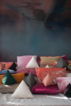 Piles of pyramid pillows. Say that ten times fast.