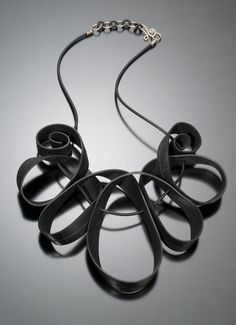 Kathleen Nowak Tucci  uses recycled rubber in the creation of her art jewlery.  all of the jewelry crafted meticulously by hand