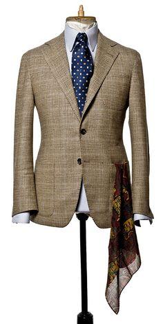 Tan glen plaid jacket, light blue shirt, blue tie