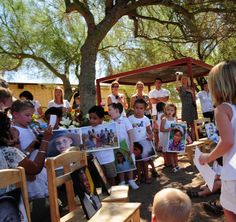 Cave Creek Montessori students showing off their peace day art!