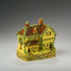 Buy online, view images and see past prices for STAFFORDSHIRE YELLOW-GLAZED ENAMELLED COTTAGE WARE STILL BANK, FIRST HALF TWENTIETH CENTURY.. Invaluable is the world's largest marketplace for art, antiques, and collectibles.