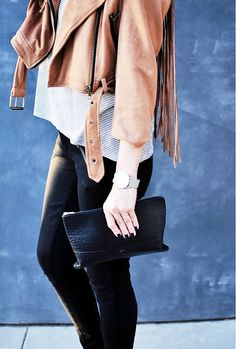 Details of a fringe moto jacket and striped tee.