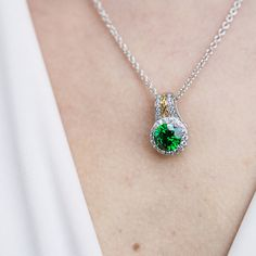 Celtic knot Halo necklace with clear and green CZ in sterling silver.