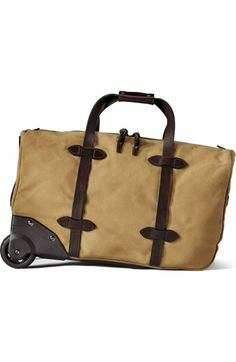 a540b26a06b Discover the Filson Small Rolling Duffle. Our heavy-duty Rugged Twill duffle  bag has leather reinforcements and stabilizing rails for added durability.