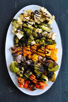 Full of color and sweet-smoky roasted flavors, this easy-to-prepare side dish features your favorite veggies roasted with olive oil and garlic, then topped with a sweet drizzle of balsamic glaze.