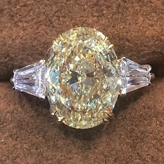 Lovely 4.0 carat fancy yellow diamond oval engagement ring.