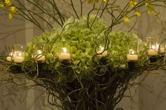 Event arrangement sith candle light   New Leaf Florist