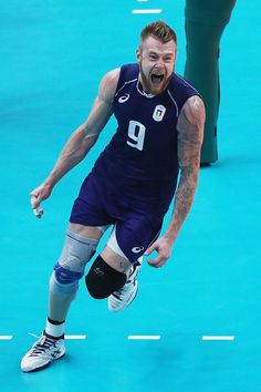 Ivan Zaytsev of Italy celebrates a point over the United States during the Men's…