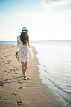 Image result for a girl walking on a beach