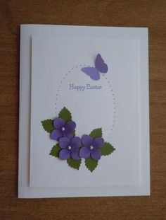 handcrafted Easter card: a flutterby Easter '15 ... clean and simple ... trio of punched violes ... pierced outline egg ... small punched butterfly ...