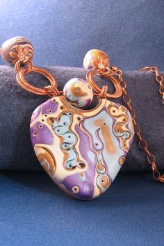 mokume gane pendent using stack method, washers used as part of the bail