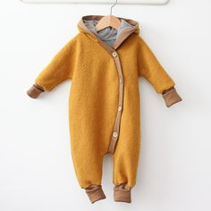 Comfy yellow baby suit.