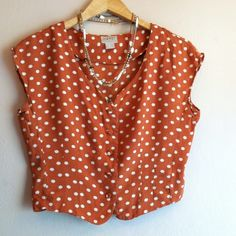 """Vintage Esprit cropped polka dot top Vintage and right on trend, this cropped top from Esprit is perfect for festival season or a picnic in the park! Burnt Orange rayon button up with vneck and capped sleeves, darted waist and fun white polka dots. In good preloved condition. Extra button included. 19""""L and 19"""" across laying flat. Size Large, please refer to measurements. ESPRIT Tops Crop Tops"""