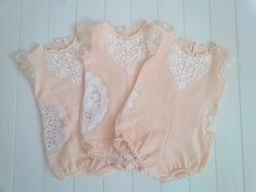 Vintage inspired romper is perfect for babies 1-2 years.Beautiful vintage lace pieces are used on the sides of romper to compliment front lace bib.Each one is unique and has slightly different lace.Back button closure and snaps in the bottom for easy dressing.Fits 1-2 years (12-24 months)