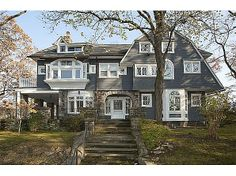 An iron gate, wide bluestone stairs and massive granite arch welcome you into this 1908 shingle Victorian perched high above the street with sweeping views over the nearly 2/3 acre of extensively landscaped property. All the detail you could hope for in a classic home plus all the updates and modern conveniences you could wish for?. #zillow