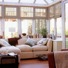 Sunroom with cloth or bamboo blinds... and a multi-panel trellis outside the windows. Lots of great British conservatory = sunroom pics at this link.