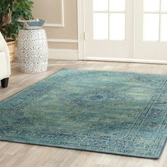 Safavieh Vintage Indoor/Outdoor Area Rug | AllModern.  This is quite inexpensive, but is one of the looks I like.