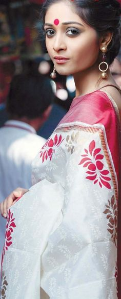 white saree with pink borders. Sigh! Rustic