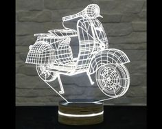 This Vespa scooter shaped LED lamp has an amazing effect. You can use it as home and office decor, table lamp, night light etc. It creates different ambience in your rooms. Lampe Led, Led Lamp, Mood Lamps, Trophy Design, Nursery Lighting, Brass Lamp, Unique Lamps, Vintage Lamps, Home Living