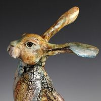 Ceramic cats, dogs, hares and cockerels slip decorated or Raku fired