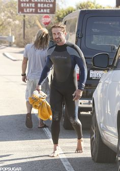 Gerard Butler suited up for the surf in LA on Friday.