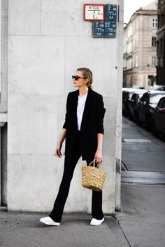 wide leg trousers outfit; minimal outfit, straw bag, platform sneakers; katiquette fashion blog