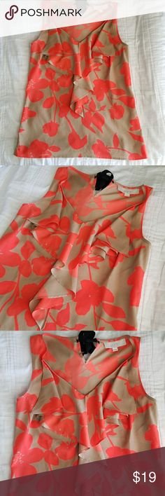 Ann Taylor LOFT Floral Print Top Ann Taylor LOFT Floral Print Top  *Tan and vibrant orange floral print *Ruffled decorative neckline *Sleeveless *Flowy and lightweight! *Black ribbon the on the back neck *Size X-small  *100% Polyester  *Excellent pre-owned condition!  ☆All reasonable offers accepted! Bundle with other pieces in my closet and save! LOFT Tops
