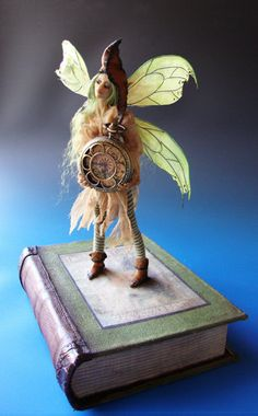 Green Bookshelf Faery.  They are quite common on bookshelves--if you have the eyes to see them.