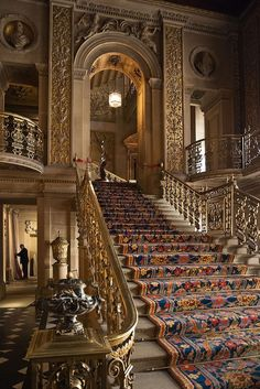 staircase in the very grand entrance hall of Chatsworth House in Derbyshire, England