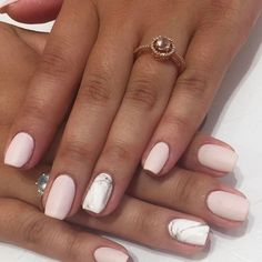 Pink nails with marble nail design, who wants to get this nail design done?
