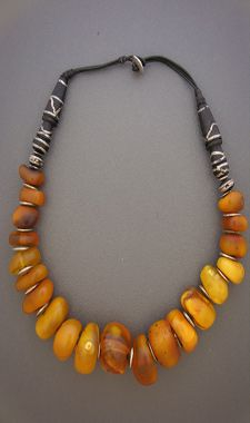 Dorje designs. Imam beads with silver inlay into the ebony beads from a prayer necklace at the top of the necklace - 22""