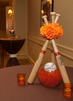 A cool sports centerpiece idea using baseball bats. Great for sports banquets and themed parties.