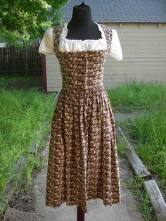 A wonderfully fun folk scene patterned brown and cream vintage dirndl dress. #brown #vintage #dirndl #dress #German #folk #costume #clothing