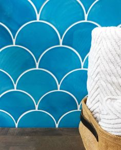 Fall weather calls for warm bubble baths! Create a spa-like bathroom with these #MoroccanFishScales! Large Moroccan Fish Scales - 1015E Caribbean Blue Mercury Mosaics scallop tile