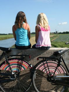 friends and bikes and cute bike accessory.