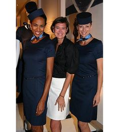 These are the uniforms for the flight attendants for Porter Airlines.  While I cannot find a picture of one ANYWHERE, I absolutely love the trench coat.  It almost makes me want to make a career change for one.