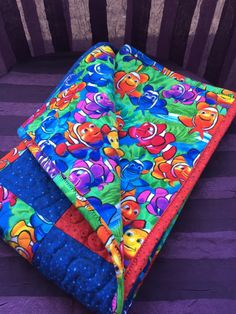 I found Nemo! A wonderful flannel quilt perfect size to throw on the grass at the park or toss it in the car for a small cover up!