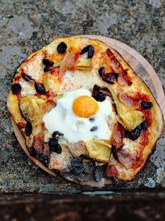 Egg, prosciutto, artichokes, olives, mozzarella, tomato sauce and basil pizza…