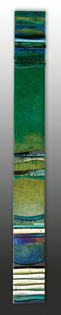 Mosaic Mystery Ocean I by Alicia Kelemen. This mosaic assemblage is created from fused glass, colored mirror, and travertine. Iridescent elements add to the shimmering quality of this wall sculpture. The elements are laminated to an MDF base, with walnut edge, ready to hang vertically or horizontally. Limited edition of 150.