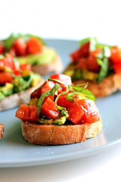 Smashed Avocado + Tomato Bruschetta Looks like a Healthy Holiday Appetizer.
