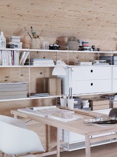 office organization // photo by Petra Bindel (I'd like to gray stain that wall!)