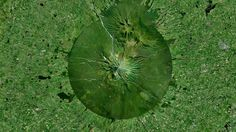 10/13/2014 Mount Taranaki North Island, New Zealand 39°17′47″S 174°03′53″E Mount Taranaki, also known as Mount Egmont, is an active stratovolcano on the west coast of New Zealand's North Island. A change in vegetation is sharply delineated between the national forest that encircles the volcano and the surrounding land comprised of intensively-farmed dairy pastures.