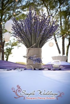 Purple is hot for 2013! This simple lavender centerpiece was designed by Desiree Munera of Simple Weddings. Click for details.