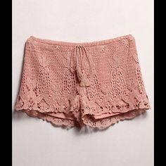 Crochet Shorts #424-ML Crochet shorts that ties in the front. 100% Polyester. Hand wash. Runs big. Elastic waist. Measurements: Waist 32-34 B-Sharp Shorts