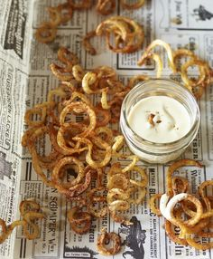 Curly Oven French Fries with Seasoned Salt:  The trick to perfectly cooked oven fries: blanch the potatoes first, dry them well, then roast them just until barely golden. For even cooking, cut the longest pieces of potatoes into shorter curls so they lie flat.