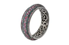 Madison Bangle from The Manhattan Collection: hand made 925 sterling silver plated with black rhodium, hand-set with multi-colored sapphires and black spinel accented by glittering aqua enamel.